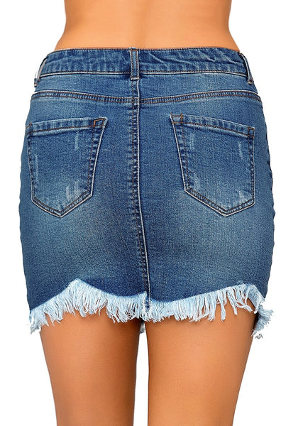Back view of model wearing dark blue frayed hem washed denim mini skirt