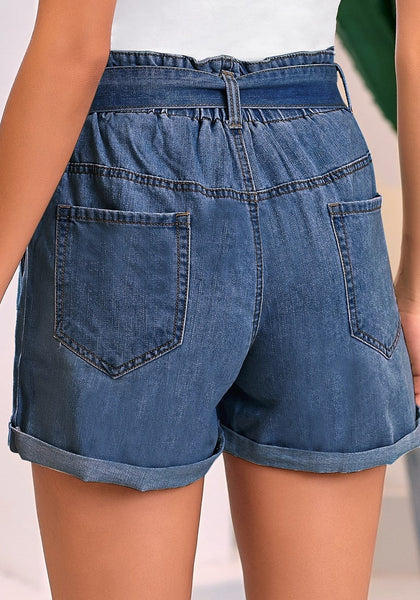Back view of model wearing dark blue high-waist belted denim shorts