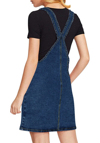 Back view of model wearing dark blue side pockets overall denim pinafore dress