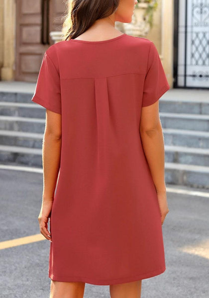 Back view of model wearing dark coral pink V-neck button down short sleeve mini dress