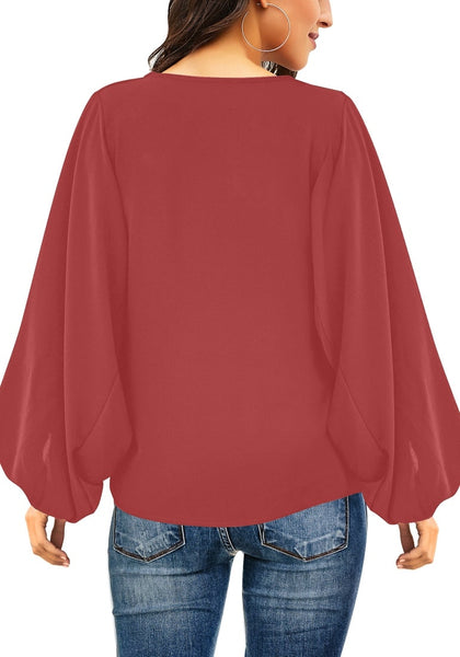 Back view of model wearing dark coral pink V-neckline balloon sleeve plain blouse