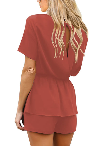Back view of model wearing dark coral pink short sleeves keyhole-back belted romper