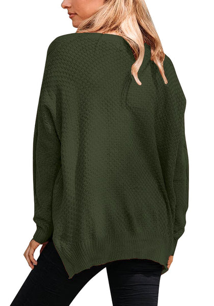 Back view of model wearing dark green ribbed knit textured side-slit sweater