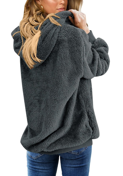 Back view of model wearing dark grey fuzzy fleece hooded oversized coat