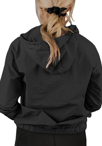 Back view of model wearing dark grey half-zip snap buttons hooded jacket