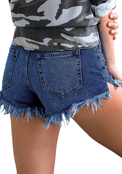 Back view of model wearing deep blue frayed raw hem distressed denim shorts