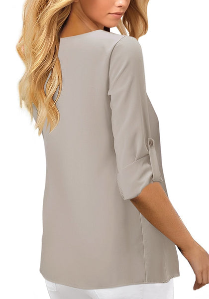 Back view of model wearing grey V-neckline 34 cuffed sleeves button-up loose top