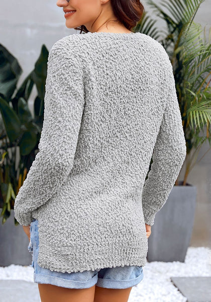 Back view of model wearing grey V-neckline popcorn fuzzy fleece pullover sweater