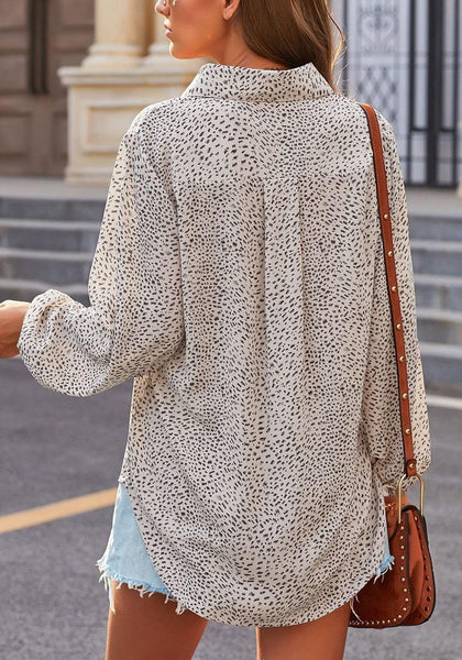 Back view of model wearing grey balloon sleeves collar V-neckline leopard-print top