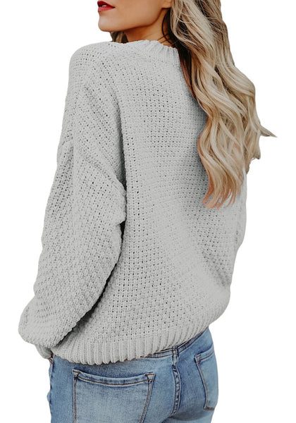 Back view of model wearing grey crew neck velvet cable knit pullover sweater