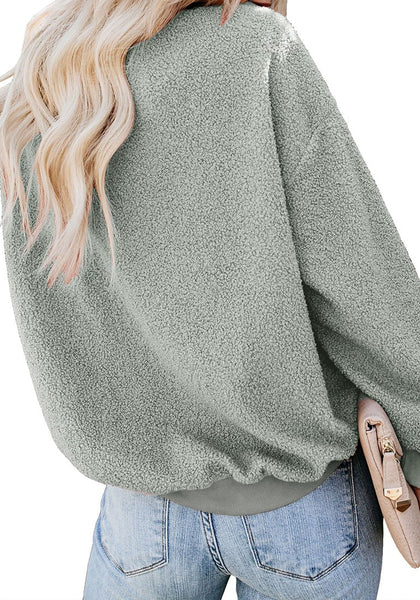 Back view of model wearing grey crewneck terry cashmere pullover sweatshirt