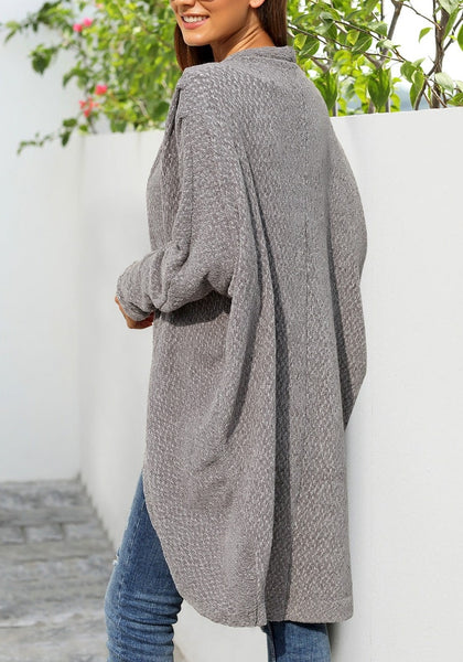 Back view of model wearing grey curved hem long chenille knit cardigan