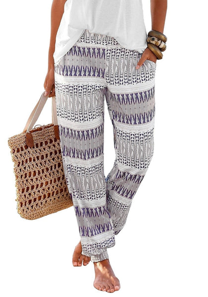Model wearing grey ethnic-print straight cut smocked pants
