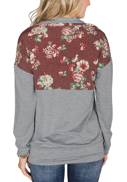 Back view of model wearing grey floral patchwork print half-zip pullover top