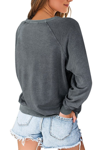 Back view of model wearing grey french terry crewneck pullover sweatshirt