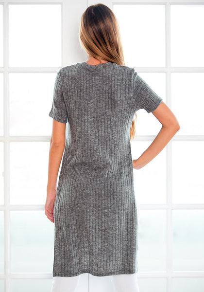 Back view of  model wearing grey high-low knit top