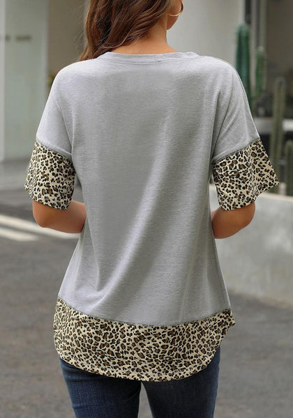 Back view of model wearing grey leopard patchwork half sleeves loose top