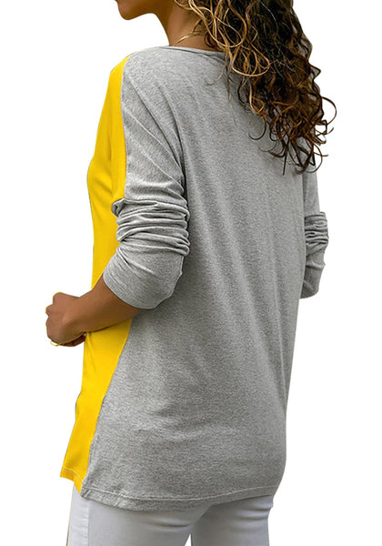 Back view of model wearing grey long sleeves color block tunic top