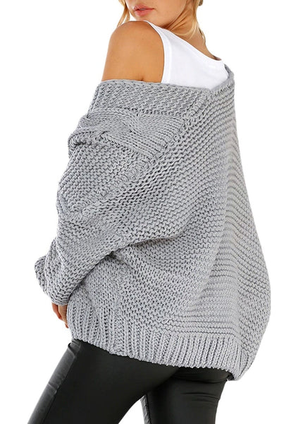 Back view of model wearing grey open-front chunky knit sweater cardigan