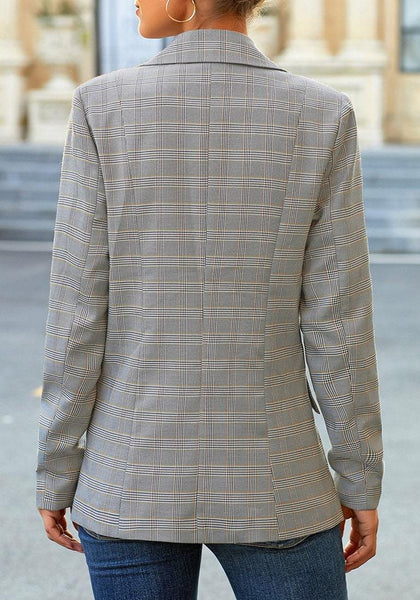 Back view of model wearing grey plaid lapel front-button side-pockets blazer