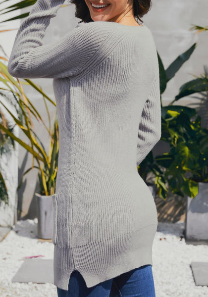 Back view of model wearing grey pockets textured ribbed knit tunic sweater