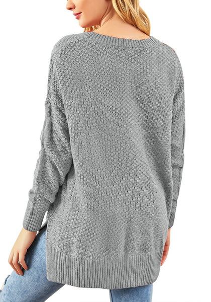 Back view of model wearing grey ribbed knit textured side-slit sweater