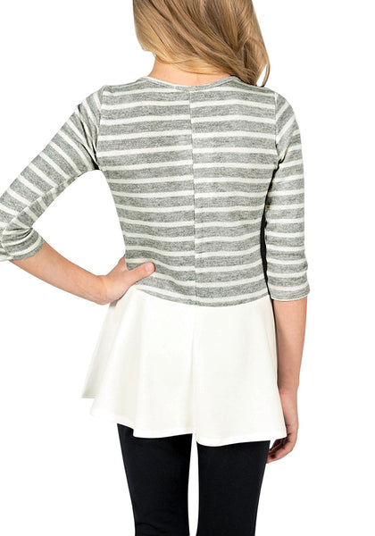 Back view of model wearing grey striped ruffle hem flared girl tunic top