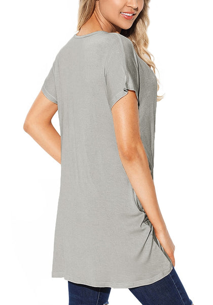 Back view of model wearing grey twist-front high-low blouse