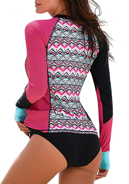 Back view of model wearing hot pink geometric-print long sleeves color block rash guard
