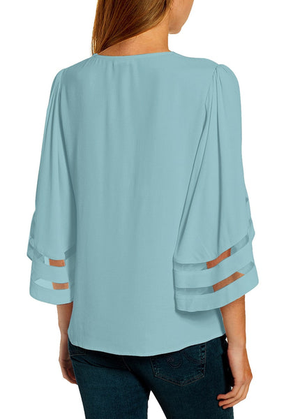 Back view of model wearing light V-neckline mesh bell sleeves loose wrap blouse
