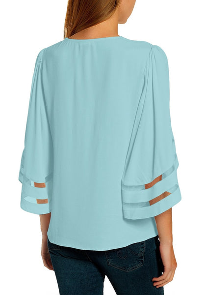 Front view of model wearing light blue 34 bell mesh panel sleeves V-neckline loose top