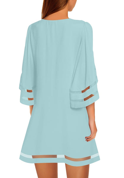 Back view of model wearing light blue 34 bell sleeves mesh panel crew-neckline loose dress