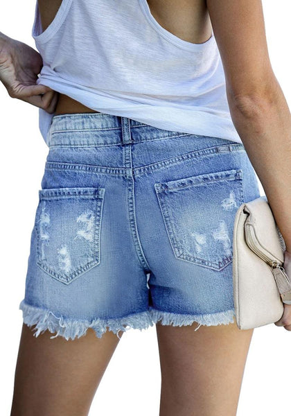 Back view of model wearing light blue double button raw hem ripped jeans shorts