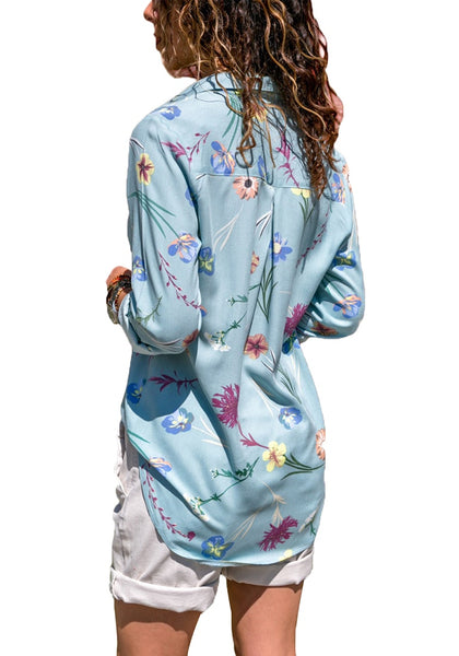 Back view of model wearing light blue floral long sleeves collared button-up top