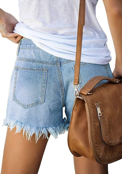 Back view of model wearing light blue frayed hem washed denim jeans shorts