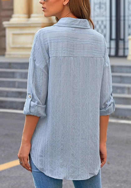 Back view of model wearing light blue long sleeves half button-up tunic shirt