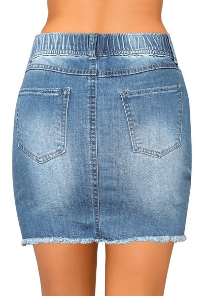 Back view of model wearing light blue raw hem drawstring distressed denim mini skirt