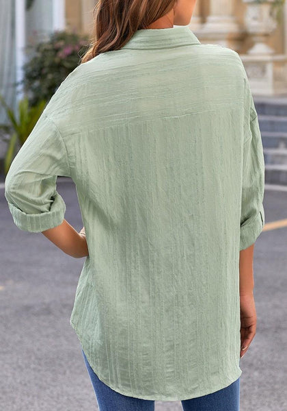 Back view of model wearing light green long sleeves half button-up tunic shirt