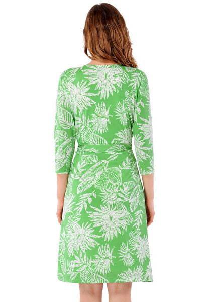 Back view of model wearing light green plant-print crop sleeves faux wrap dress