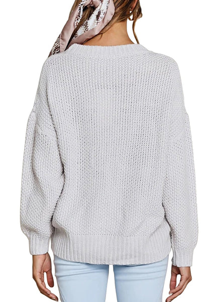 Back view of model wearing light grey ribbed crochet knit oversized sweater