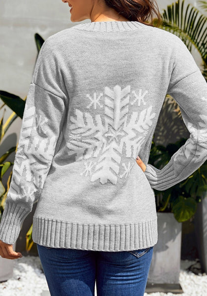 Back view of model wearing light grey snowflake ribbed knit Christmas sweater