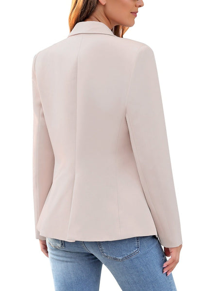 Back view of model wearing light mauve notch lapel double-breasted blazer