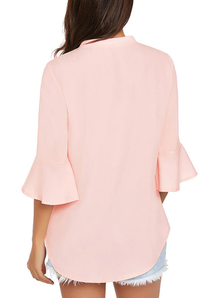 Back view of model wearing light pink V-neck flare sleeves loose chiffon blouse