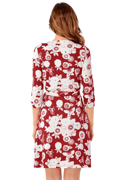 Back view of model wearing maroon floral plunge wrap dress