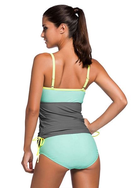 Back view of model wearing mint ruched tankini set