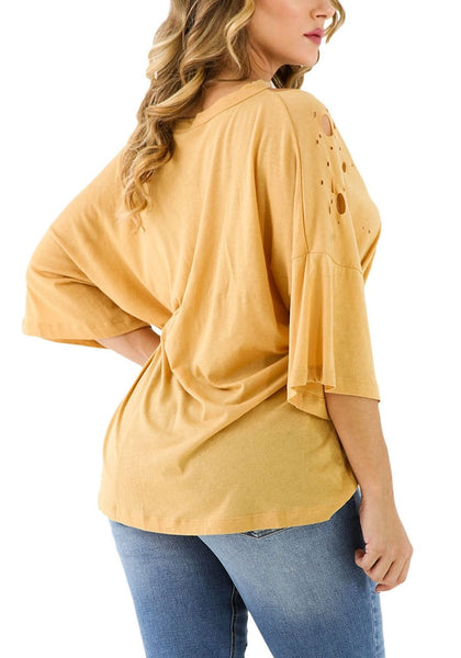Back view of model wearing mustard graphic-print distressed loose top