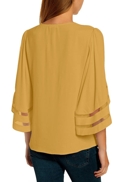 Back view of model wearing mustard yellow 34 bell mesh panel sleeves V-neckline loose top