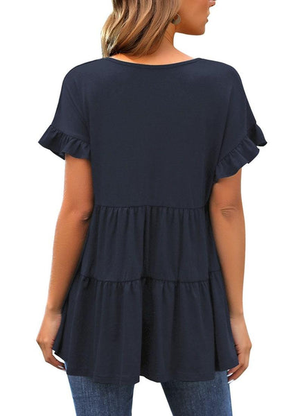 Back view of model wearing navy V-neck ruffled short sleeves tiered tunic top
