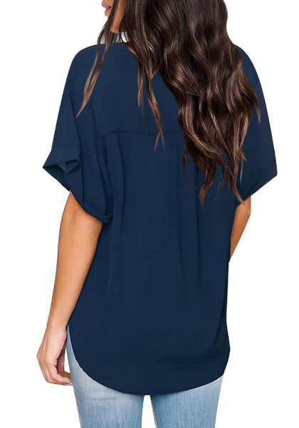 Back view of model wearing navy V-neckline cuffed sleeves loose wrap blouse