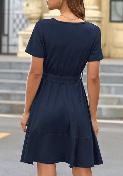 Back view of model wearing navy V-neckline short sleeves belted ruffle dress